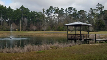 wolf-bay-landing-condominiums-fishing-pond